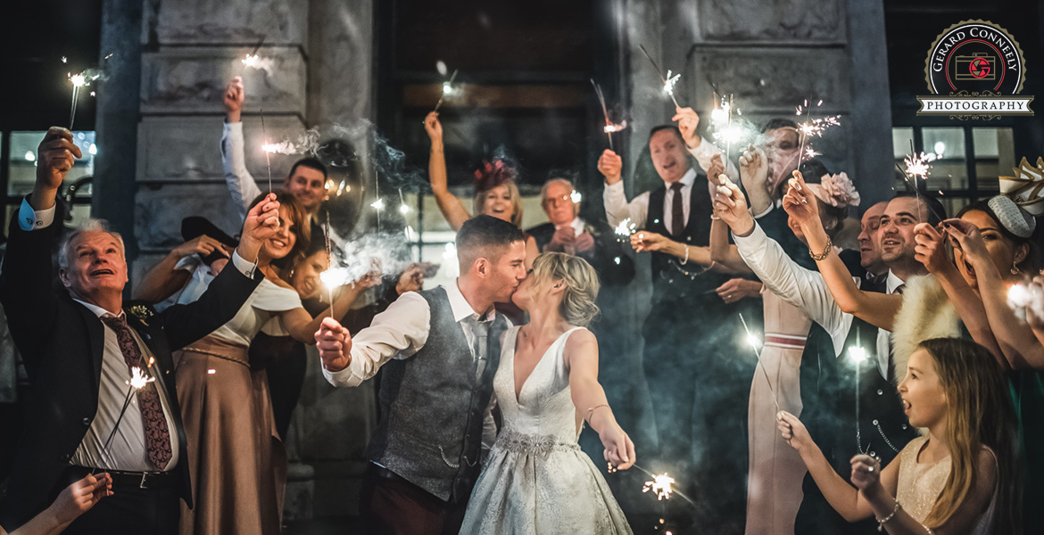 wedding couple with sparklers at the Meyrick hotel in Galway photo by gerard conneely photography