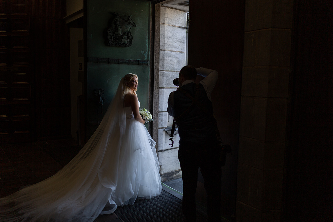 Behind the scenes photo of Gerard Conneely photographing a wedding at Galway Cathedral