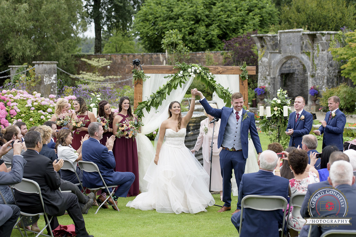 dromoland castle outdoor wedding ceremony in the walled garden
