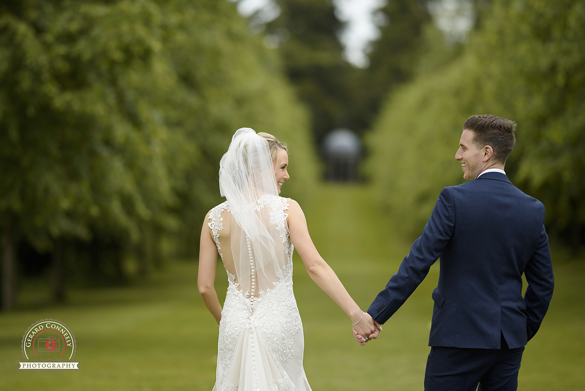 dromoland castle wedding bride and groom walking hand in hand