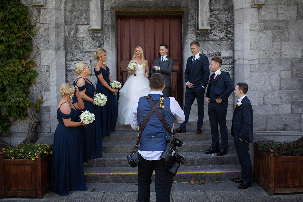 Behind the scenes photo of Gerard Conneely photographing a wedding at NUIG