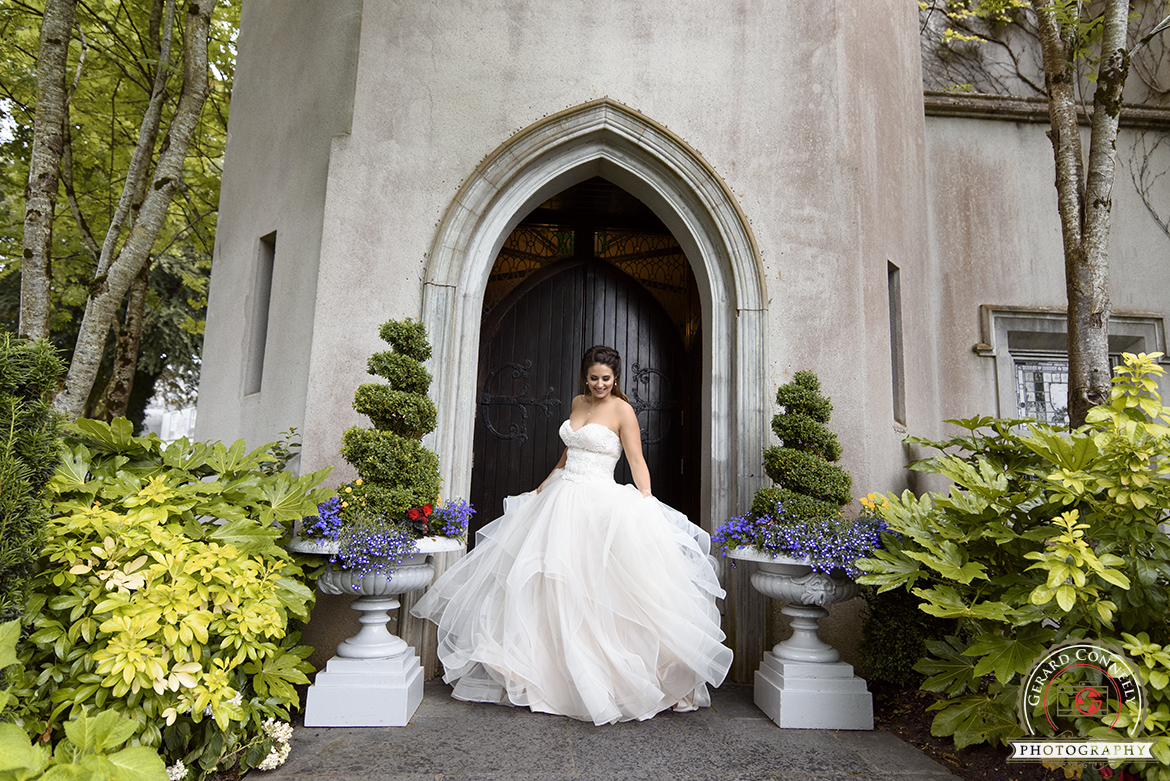 photography of bride dancing with her stunning dress at dromoland castle on her wedding day
