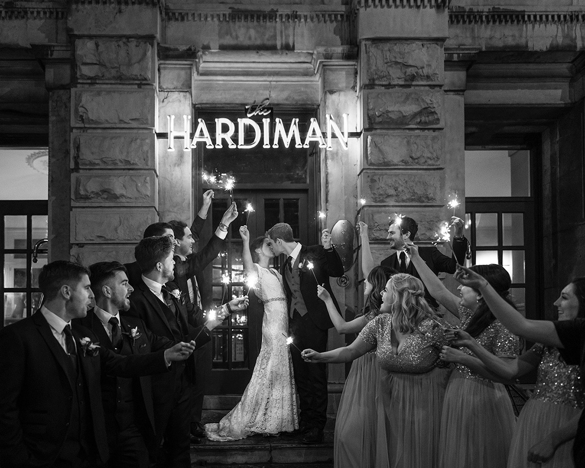 Wedding photography of bridal party with sparklers at the Hardiman hotel in Galway with Gerard Conneely